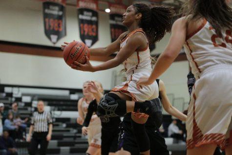 Varsity Girls' Basketball Overthrows Raiders 44-34