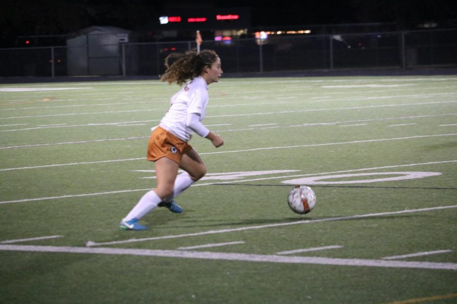 Leah Martinez 19 looks for a teammate to pass the ball to.