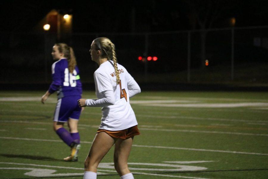 Olivia Graves 18 looks across field for the ball.