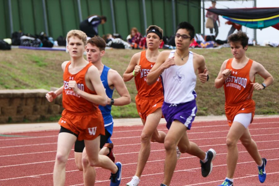 Westwood runners stay in the front of the pack during the 3200-meter run.