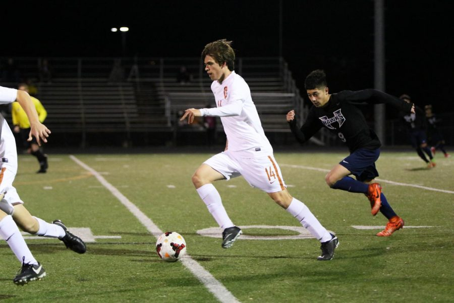 Skylar Cupit '18 dribbles the ball down the field.