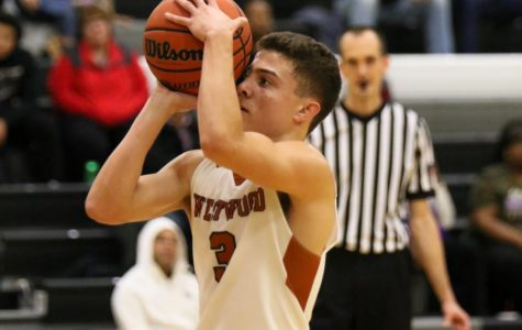 Varsity Boys' Basketball Conquers Raiders 68-61 Advancing to Playoffs