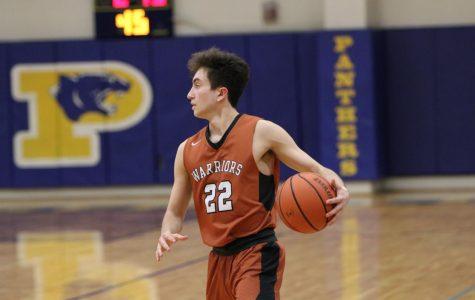 Varsity Boys' Basketball Defeats Pflugerville 53-51
