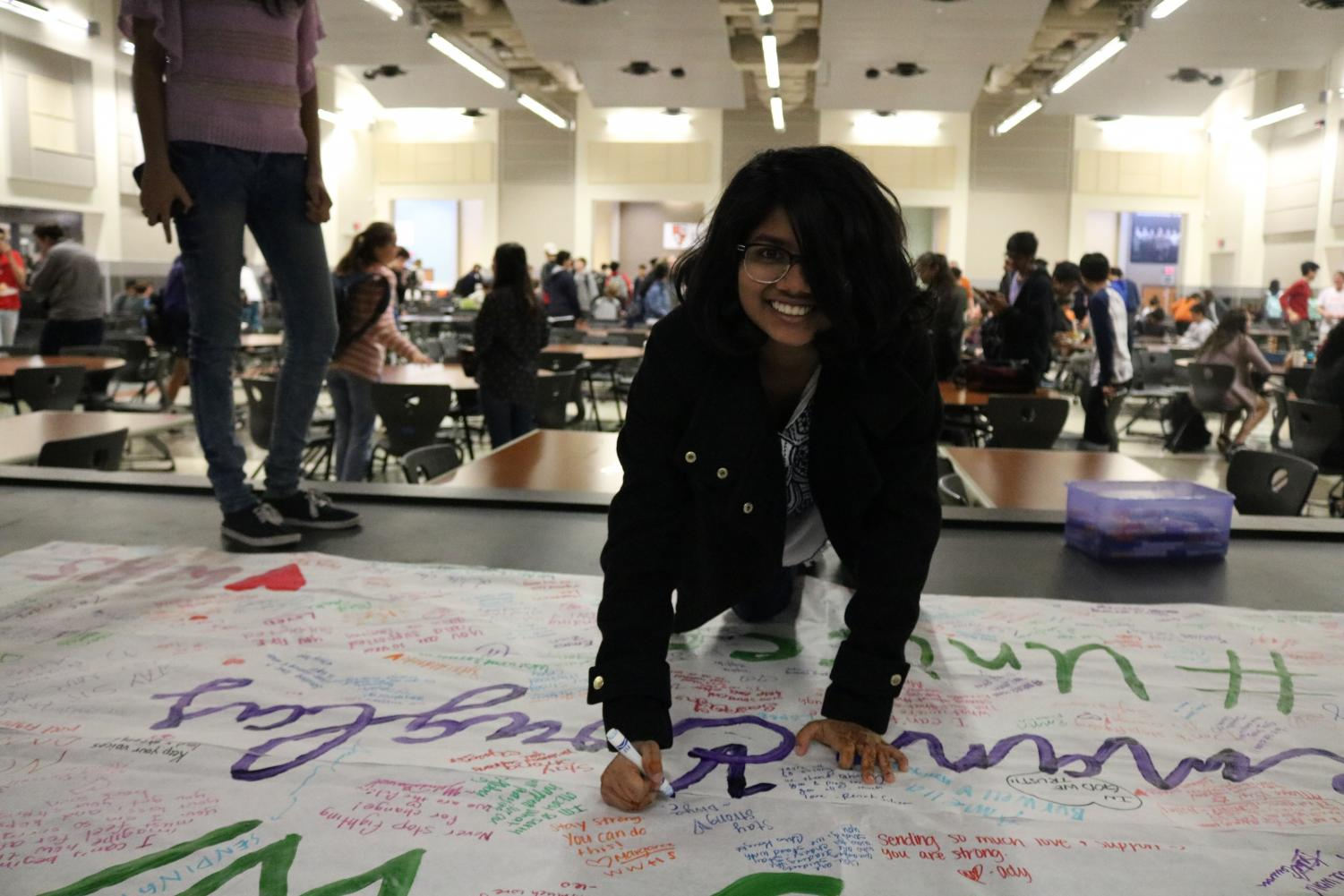 Divya+Chotani+%2720+smiles+while+writing+on+the+banner+in+support+of+the+victims+of+the+Parkland+shooting.