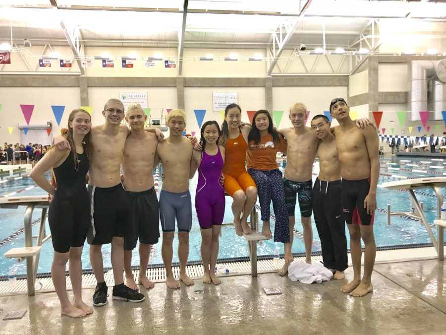 Swimmers pose together following their success at the meet. Photo credit to Westwood Swim and Dive.