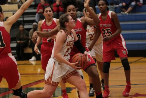 Varsity Girls' Basketball Overthrows Del Valle in First Round of Playoffs 80-61
