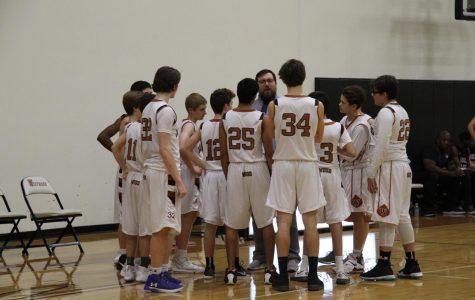 Freshman White Boys' Basketball Faced-off to Dragons