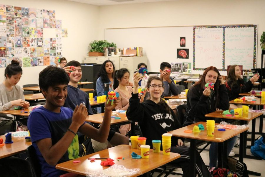 Ms. Minters class holds up their Play-Doh brains.