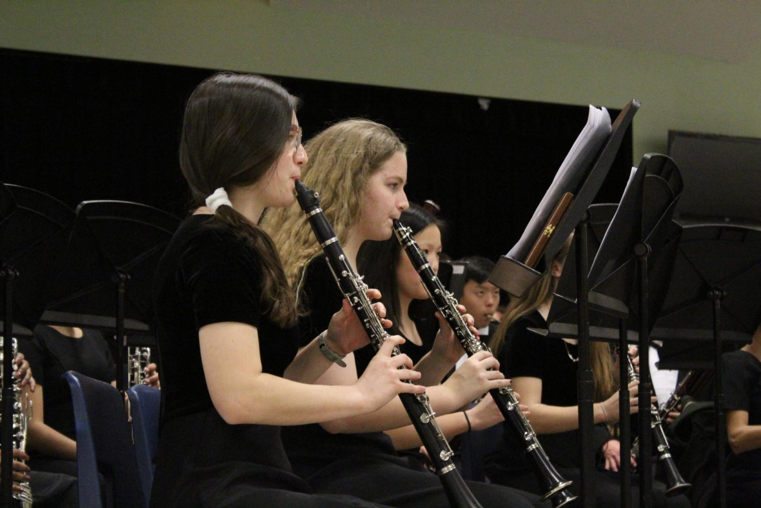 Danielle Efruss '18 and Sydney Thornburrow '20 play their clarinets in their most technical piece.