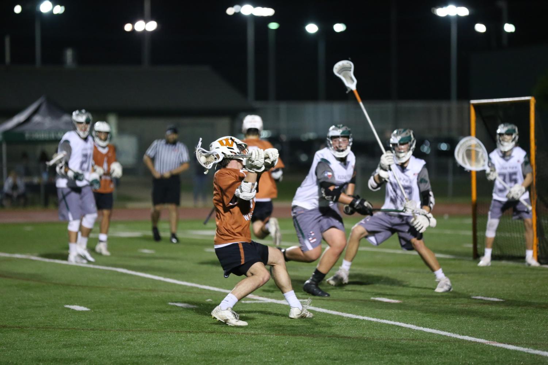 Hayden+Franks+%2718+winds+up+to+shoot+through+Cedar+Park+defenders.