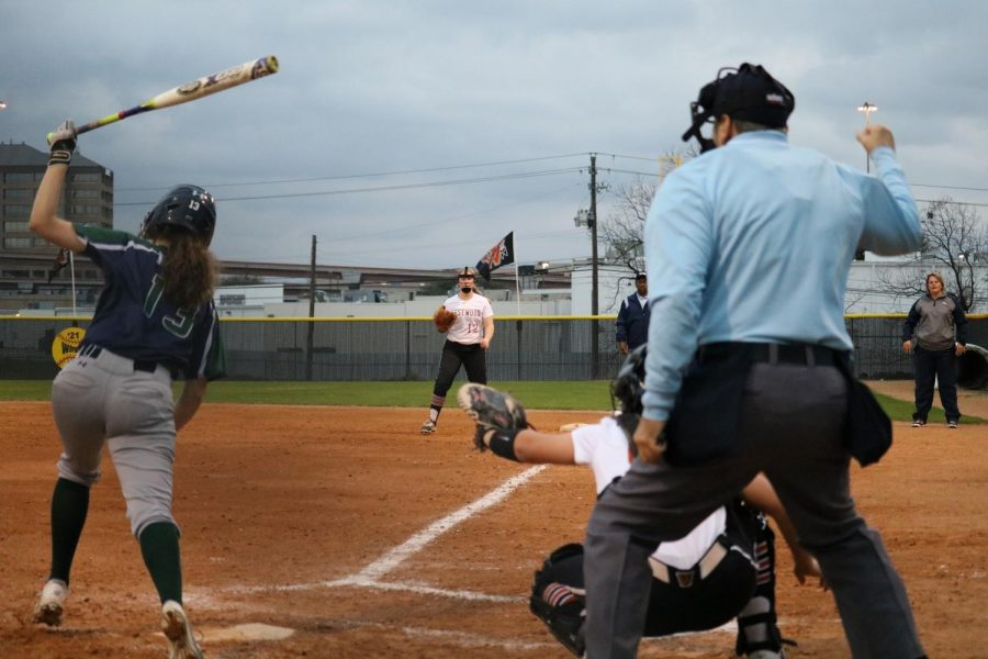 The umpire calls a strike thrown by pitcher Haley Popelka '18.