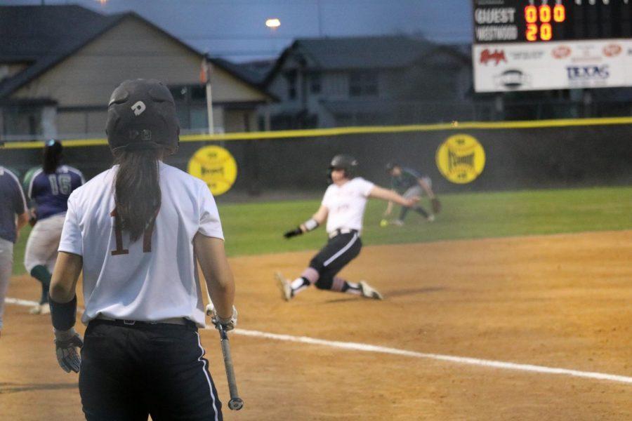 Eileigh White '21 slides safe at third base.