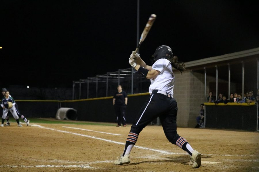 Natalie O'Connor '20 shows off her arm muscle as she swings away.