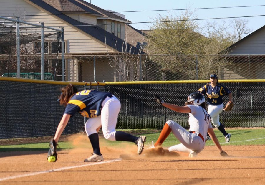 Sofia Figeroa '19 outbeats the Tiger's third baseman with her slide at third.