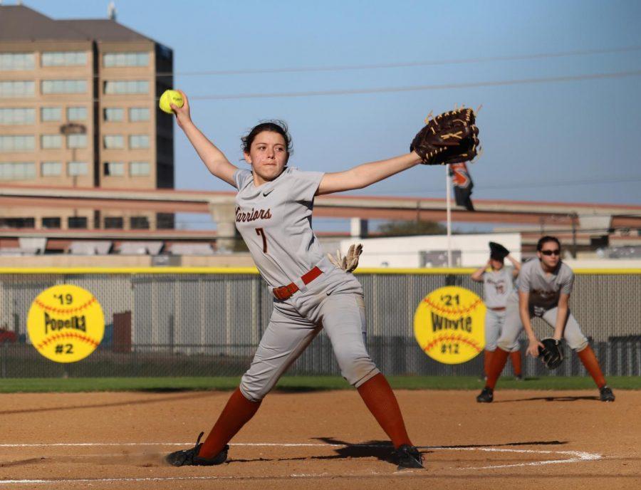 Bella Gallardo '21 winds up her pitch.