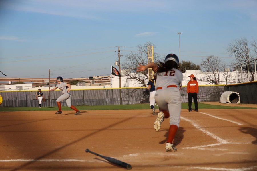 Justine Garcia '21 sprints to first base.
