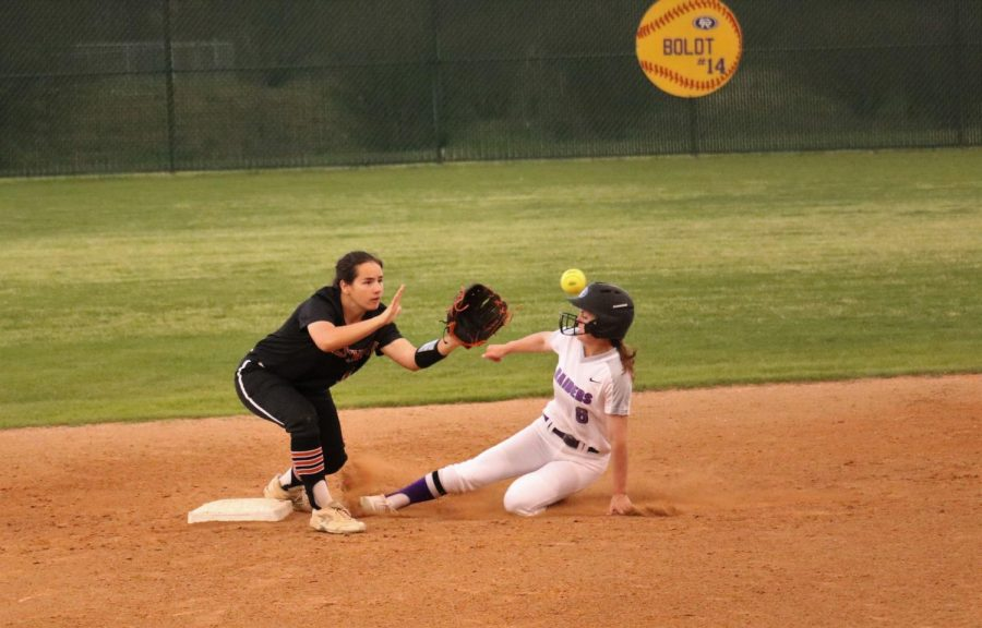 Natalie O'Connor '20 catches the ball at second base as a runner tries to steal.