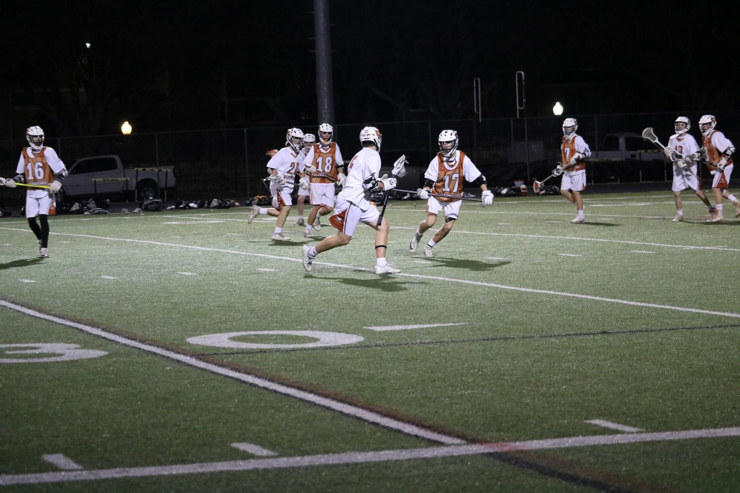 The+Westwood+Varsity+lacrosse+team+warms+up+before+their+game.