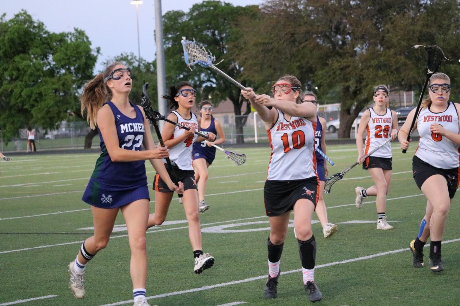 Anna Hagan '18 blocks the ball from a McNeil player.