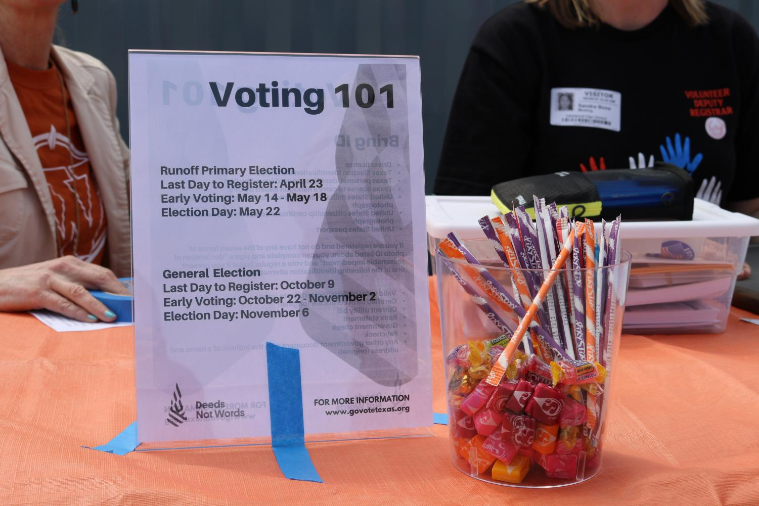 The+voter+registration+table+displays+signs+with+info.+