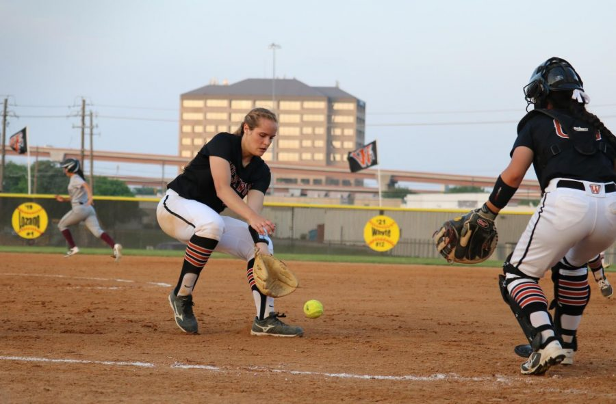Haley Popelka '18 catches the bunt from a Dragon batter.