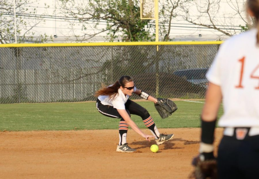 Chelsea Terranova '19 fields the ball and throws to first.