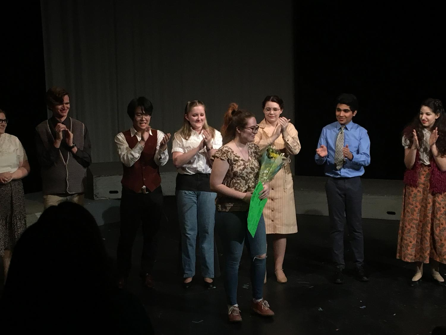 The cast of 'Missing Piece' assembles on stage with their director.
