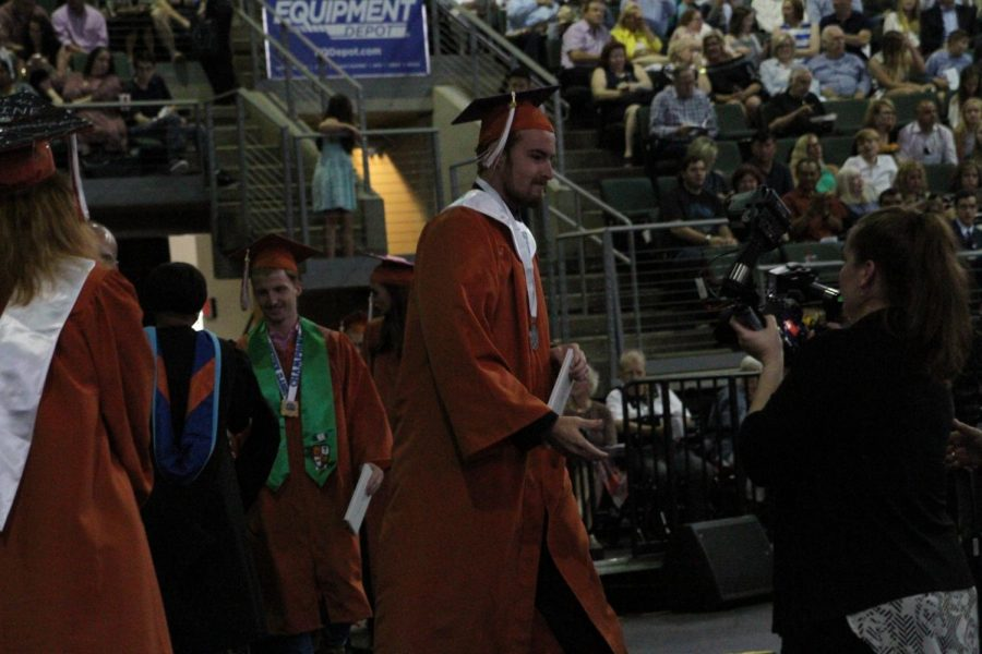Dylan Frazier 18 walks off stage after receiving his diploma.