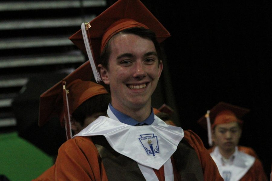 Senior smiles before going on stage to receive his diploma.