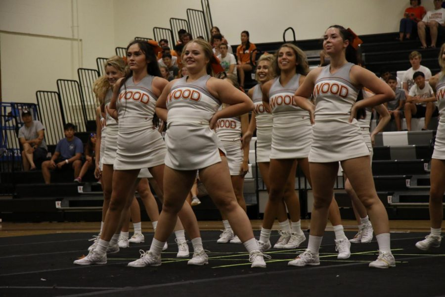 Varsity cheer performs during Meet The Warriors.