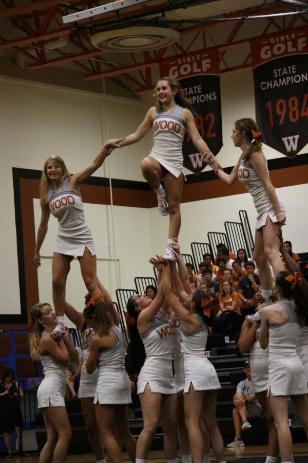 Varsity cheer shows off their stunts for the freshmen.