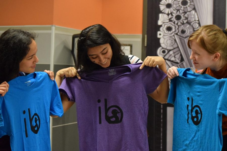 Sophomores Priyanka Gupta, Anouka Saha, and Violet Burns show off their newly made T-shirts.