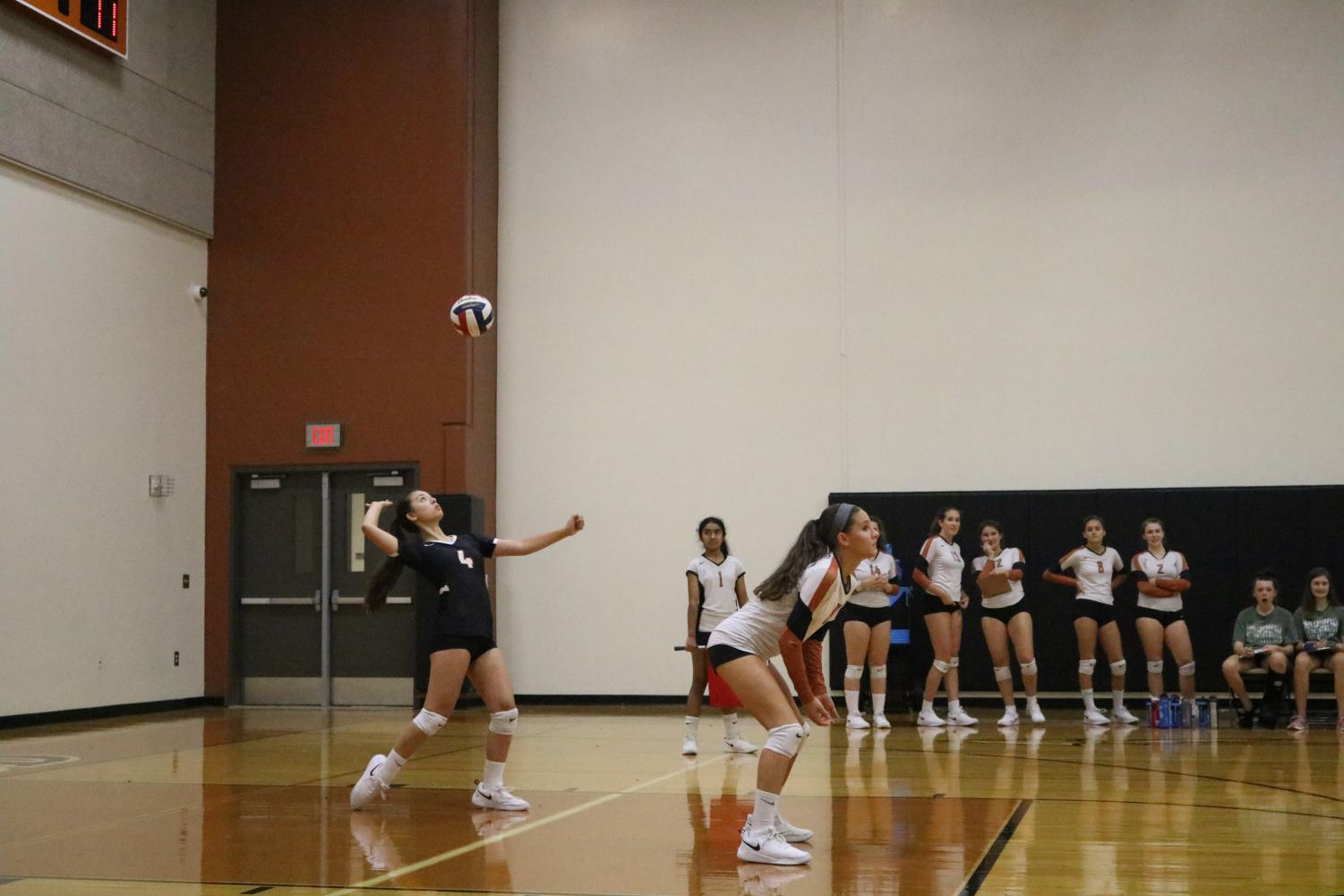 Izzy+Correll+%2722+serves+the+ball+to+the+opposing+team.+