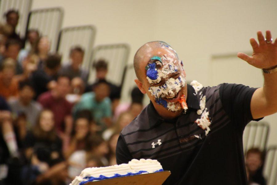 Principal Mario Acosta gets a third cake to the face.