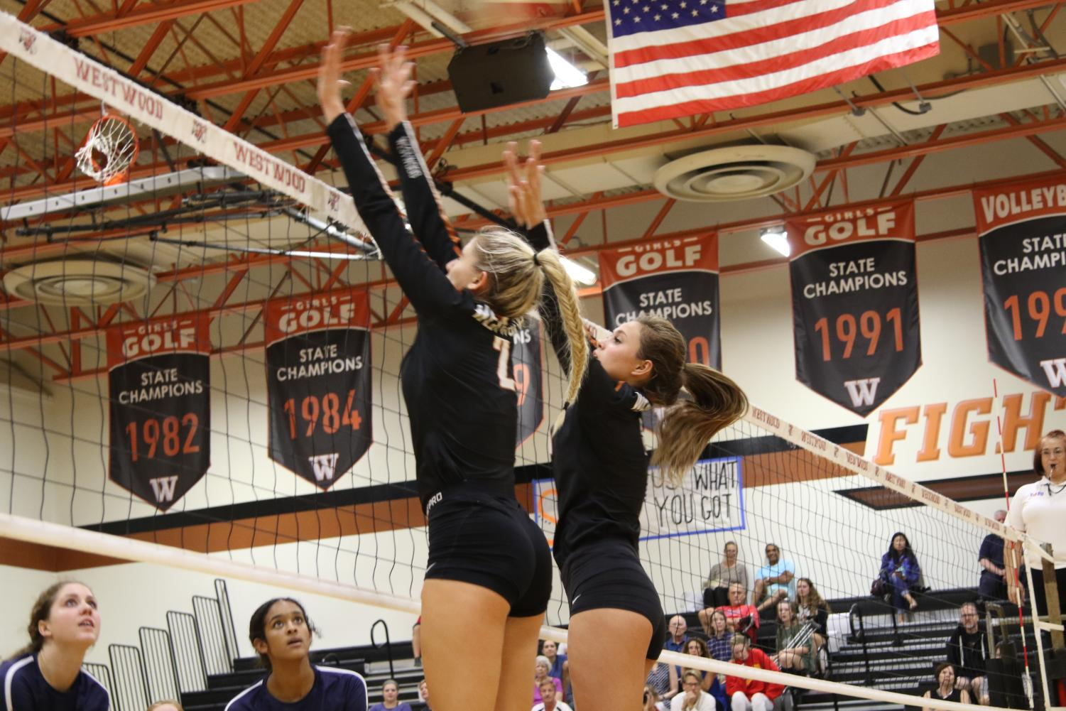 Maggie+Stout+%2719+and+Abby+Gregorczyk+%2721+block+a+spiked+ball.+