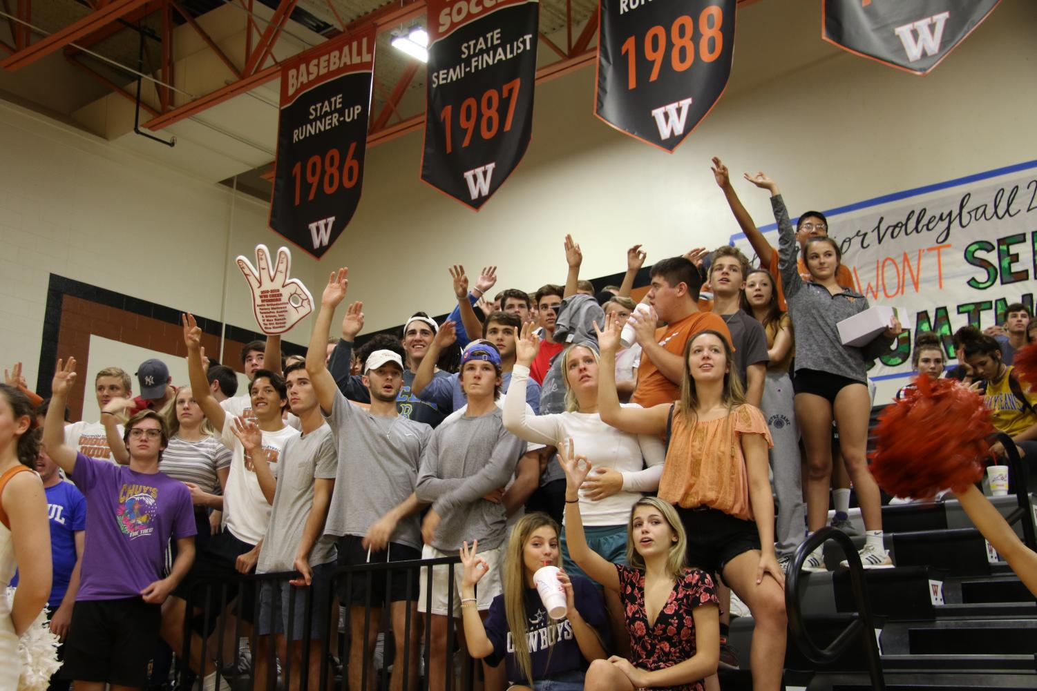 The+student+section+does+%22Woods+Up%22+on+match+point.+