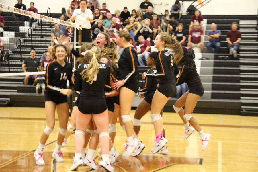The varsity girls celebrate their win against the Round Rock Dragons.