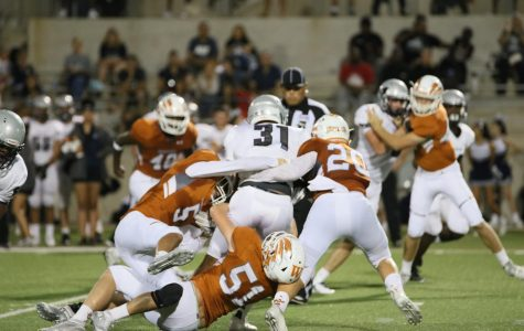 Nathan Potter '20, Josh Shoup '19, and Connor Cooper '20 work to bring down a Hendrickson player.