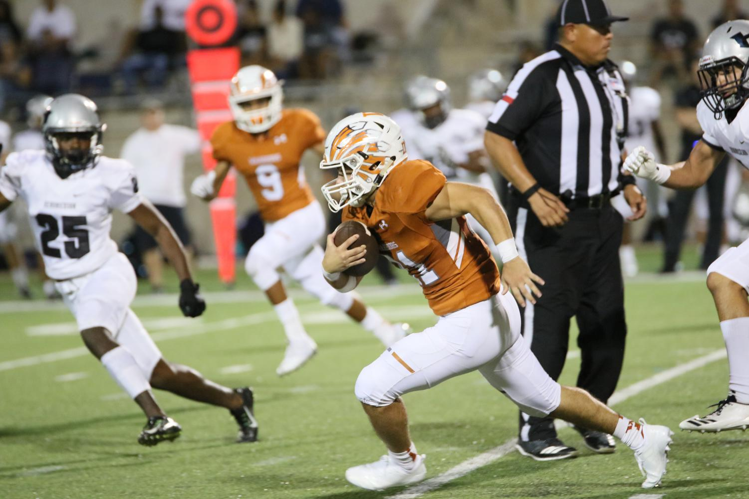 Varsity+Football+Blown+Out+64-14+To+Begin+District+Play