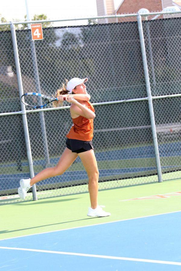 Sophie Kardonik '19 hits the ball.