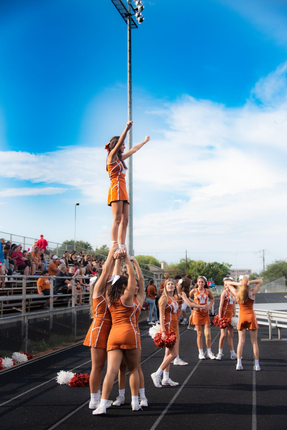 The+Westwood+Cheerleading+Squad+prepares+before+the+game+against+Vista+Ridge.