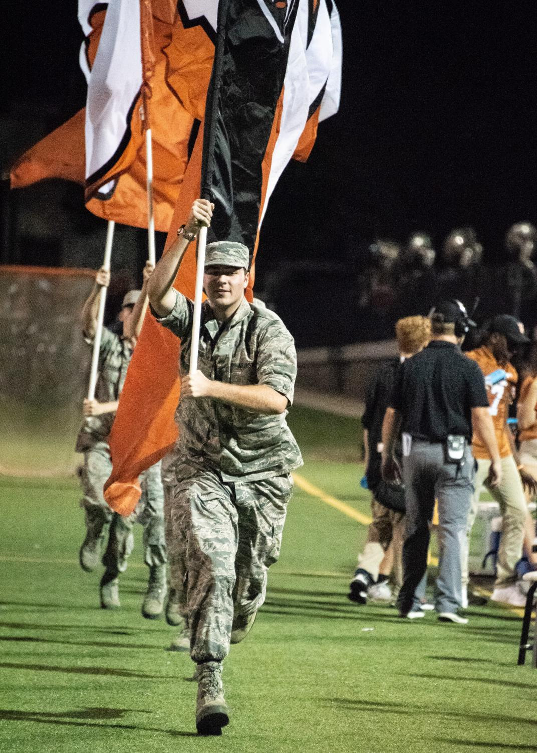 Westwood+Airforce+JROTC+runs+along+the+bleachers+holding+some+Westwood+flags+after+a+touchdown.