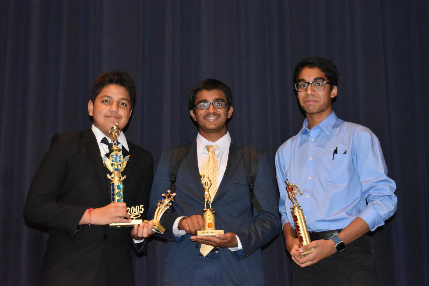 Novice+Extemporaneous+Speaking+medalists+pose+with+their+trophies.+Photo+courtesy+of+WHS+Speech+and+Debate.