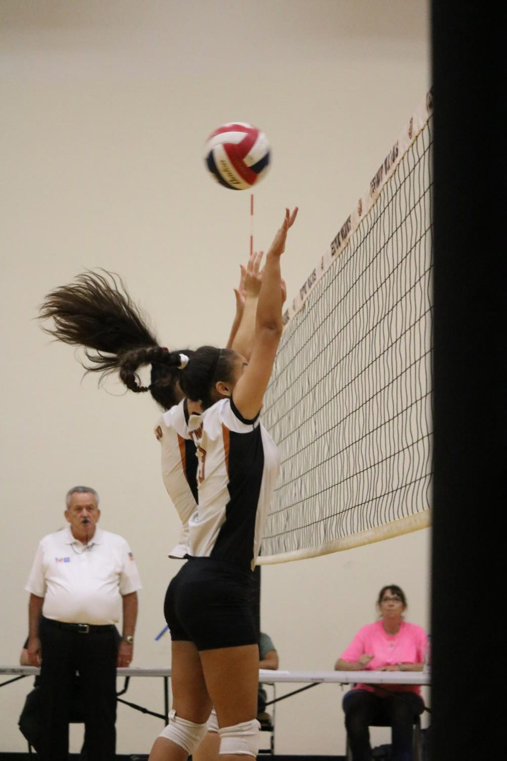 Milacey+Gremillion-Llanos+%2722+and+Lauren+Lopato+%2722+attempt+to+block+the+ball+from+getting+over+the+net.