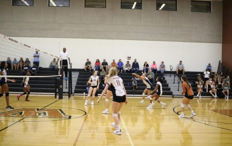 Militzy Gremillion-Llanos '22 bumps the ball in a game against Hendrickson on Oct. 16.