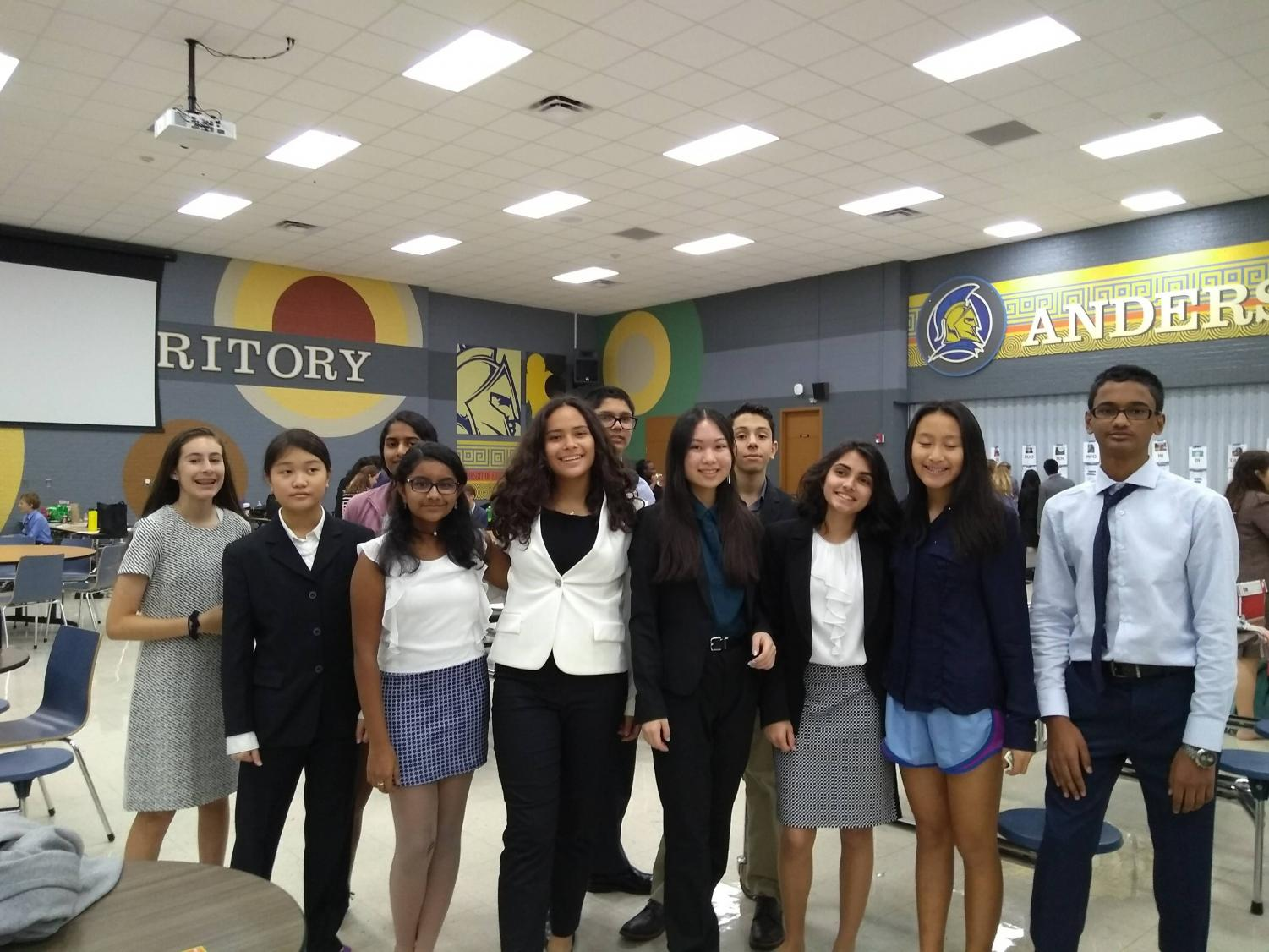 Students+competing+in+Novice+Extemporaneous+Speaking+take+a+group+photo.+Photo+courtesy+of+WHS+Debate.