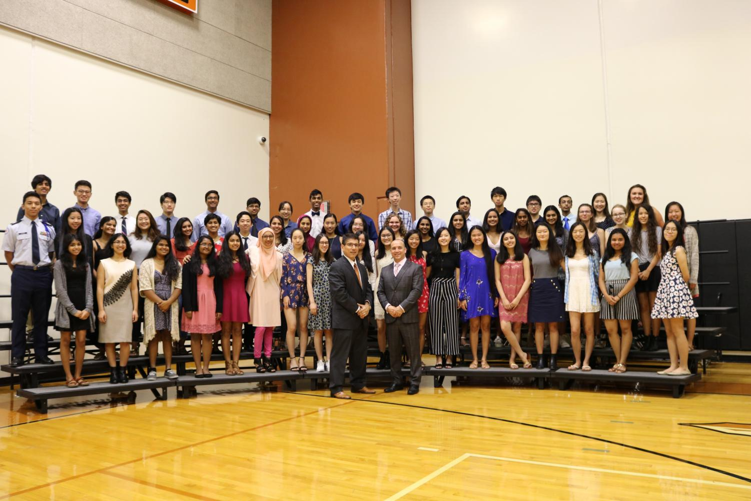 National+Merit+Semifinalists+pose+for+a+group+photo.