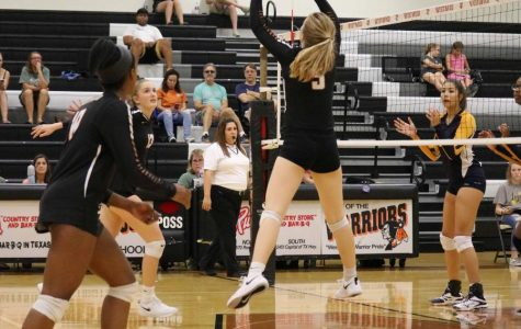 Lauren King '20 sets and prepares the ball for Madeline Shrull '21 to spike it over.