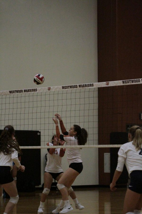 Bella Garcia 21 hits the ball to opposing court side.