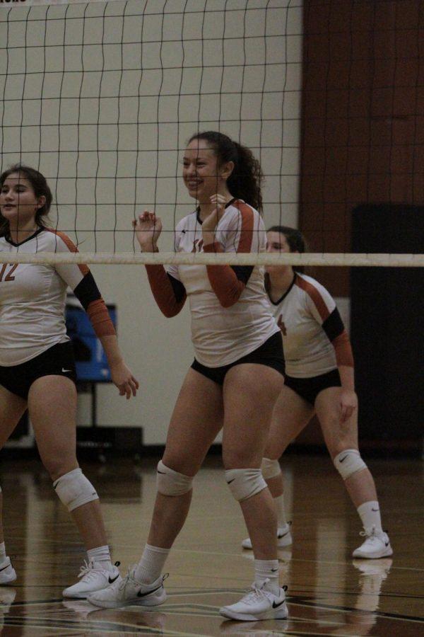 Bella Garcia 21 , Emma Marsden 21, and Lauren Kelley 21 in place to defend their court side.